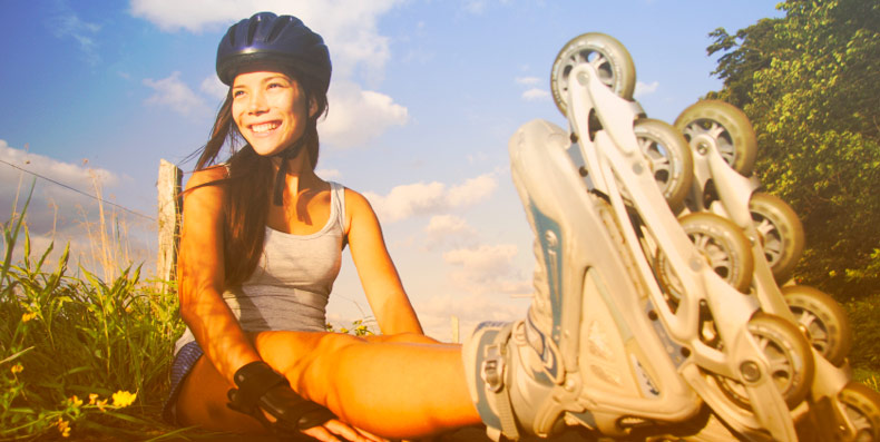 girl sitting with roller blades on